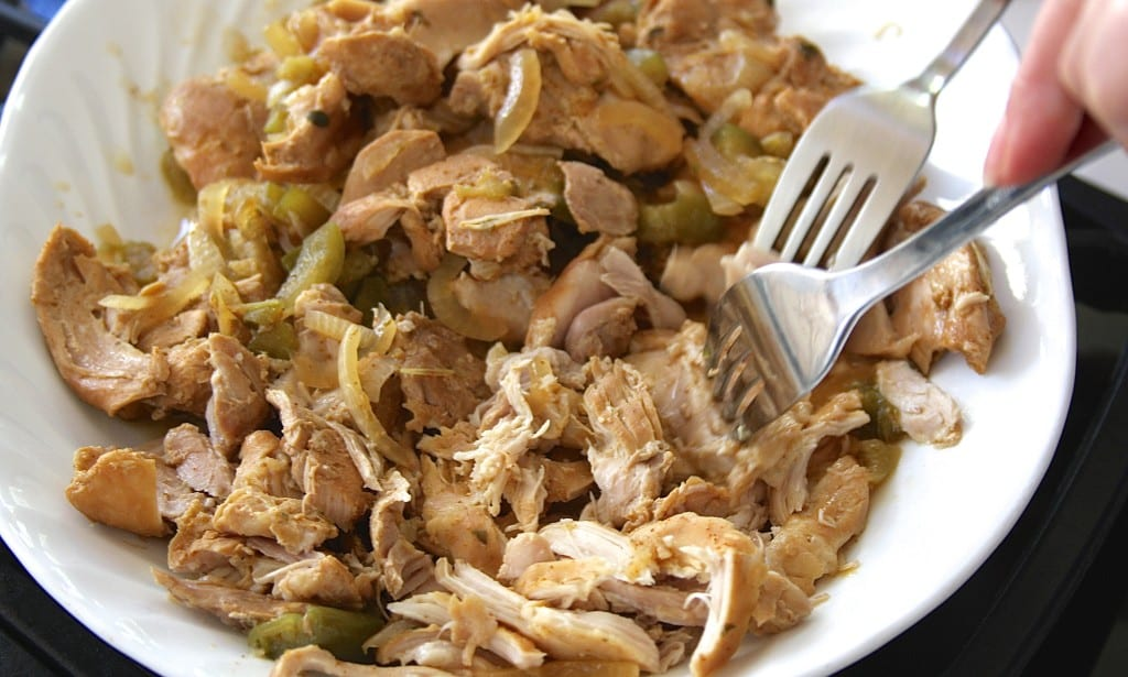 Shredding meat for Crockpot Shredded Chicken Tacos