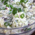 Skinny Red Potato Salad recipe is light and savory. Perfect for summer BBQ's. This is a crowd hit every time.