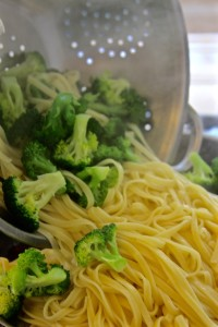 Draining noodles & broccoli for Roman Pesto Pasta