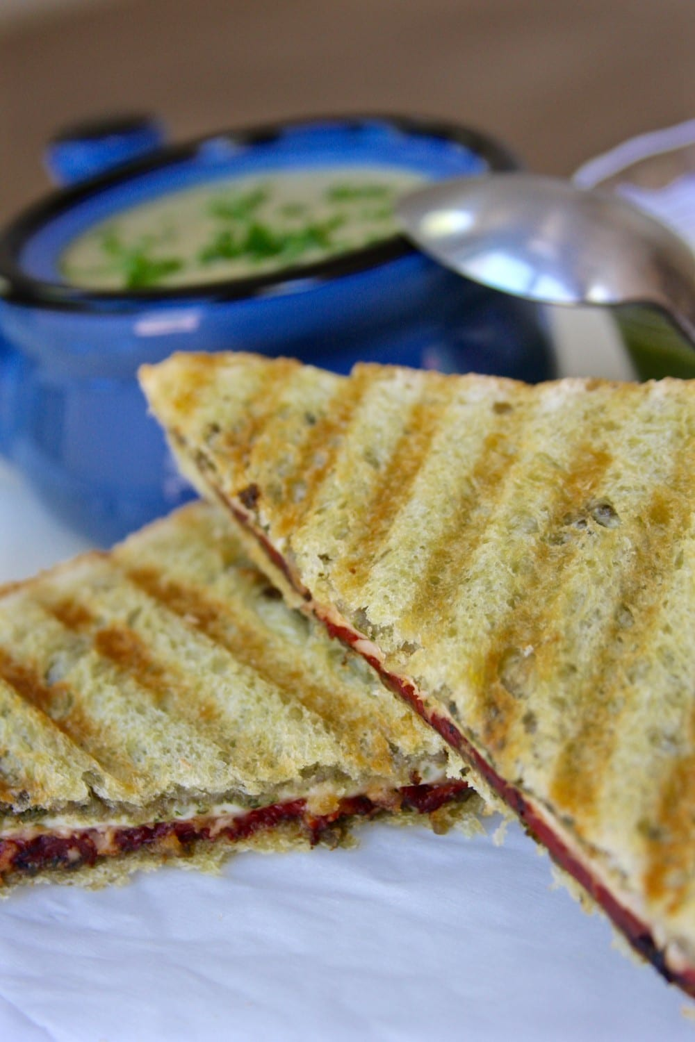 Turkey Pesto Panini is a comfort food recipe that goes beautifully with soup. Roasted red peppers and pesto make this sandwich extra special.