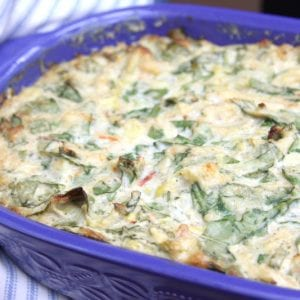 Hot or Cold Crab Veggie Dip recipe- artichokes, fresh spinach, greek yogurt. Easy to make a meal out of this recipe because so good. Great way to sneak veggies in.