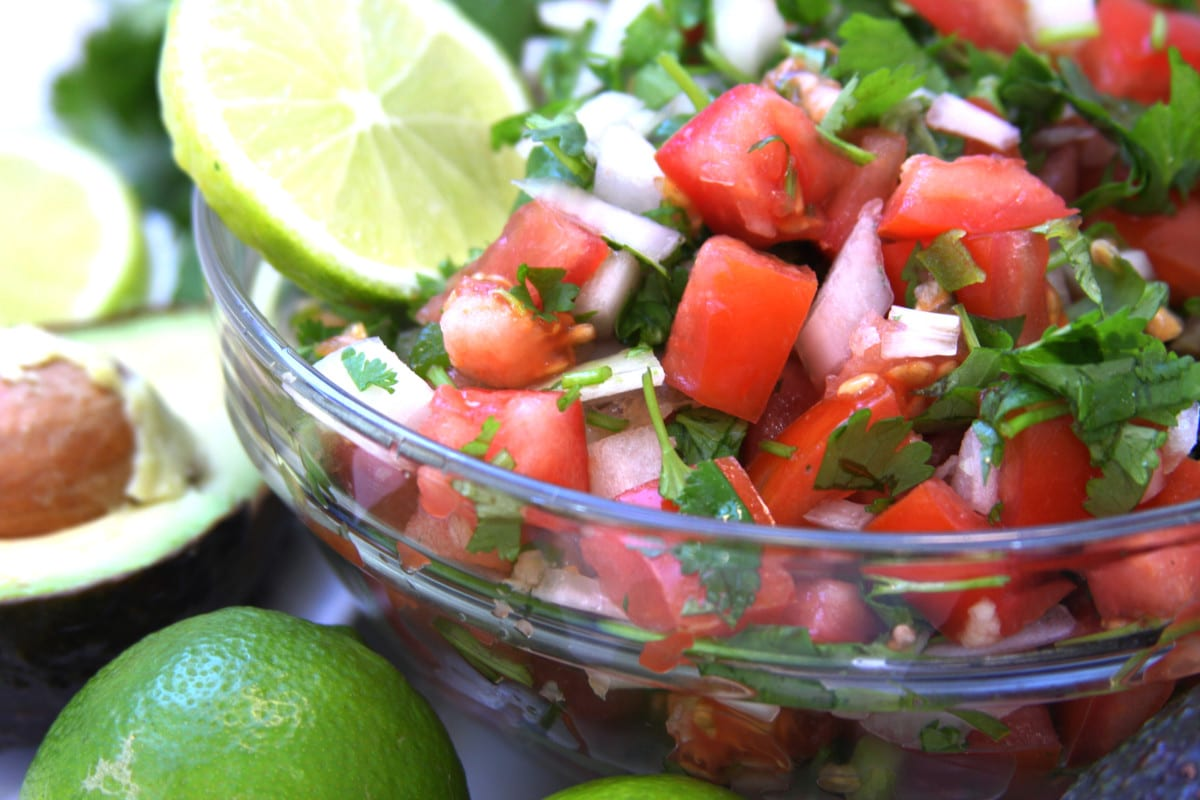 Pico De Gallo recipe is fresh, chunky and flavorful. Perfect with chips, tacos, omelettes , etc.