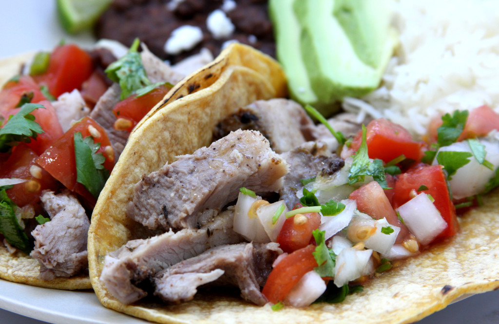 Garlic Studded Slow Cooker Carnitas Tacos recipe has garlic nestled into the roast. Seasoned with a dry rub of chipotle, oregano and thyme. Our mouths watered all day while it was cooking.