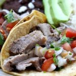 Garlic Studded Slow Cooker Carnitas Tacos