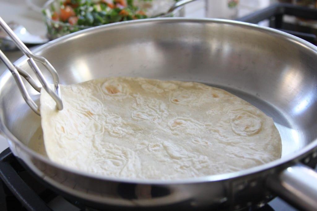 Heating tortilla for The Black Bean Burrito