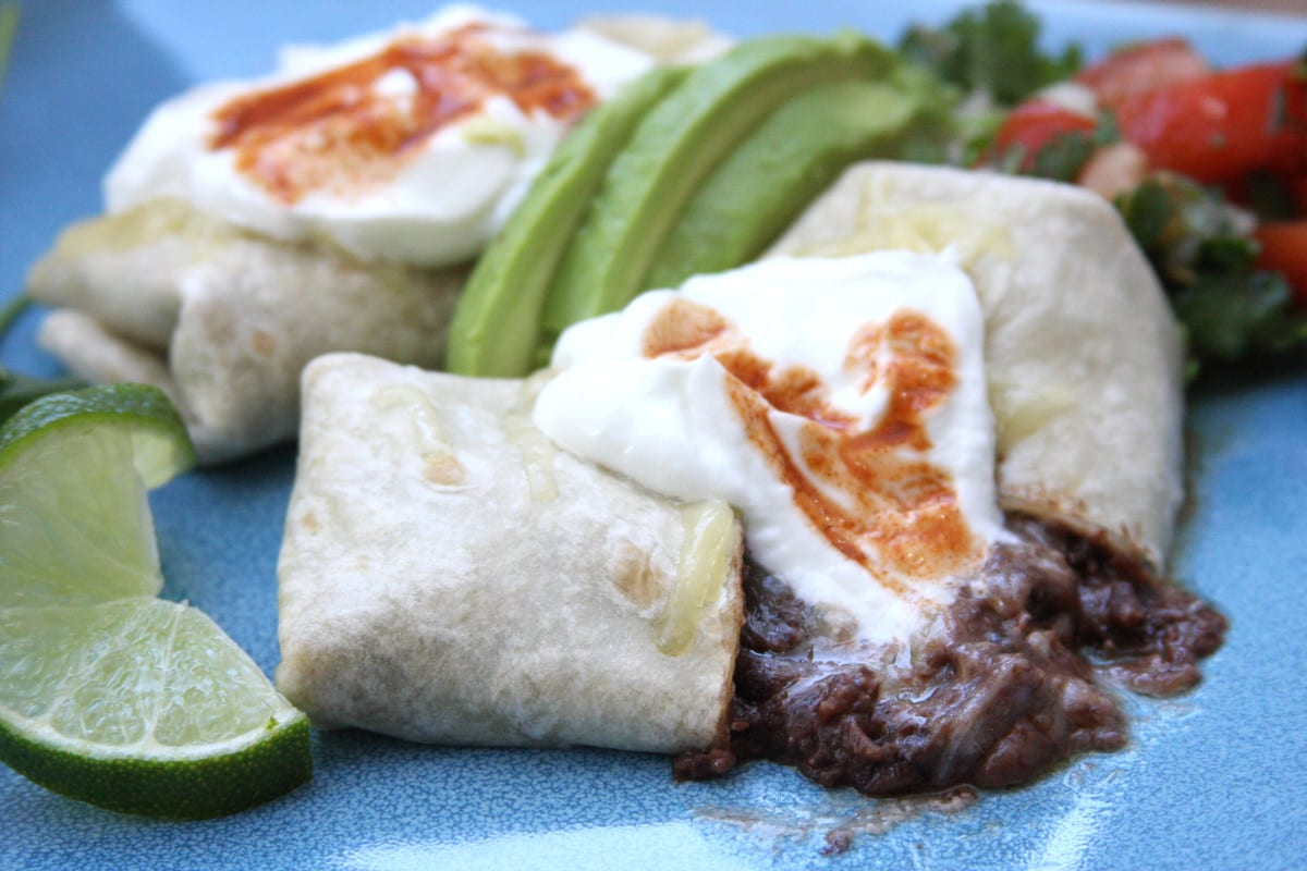 The Black Bean Burrito 1 recipe is organic & budget friendly. Zesty, rich beans with creamy and tangy cheese will make you feel like you are eating like a king.