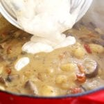 Adding tempered yogurt to Creamy Gnocchi Mushroom Soup