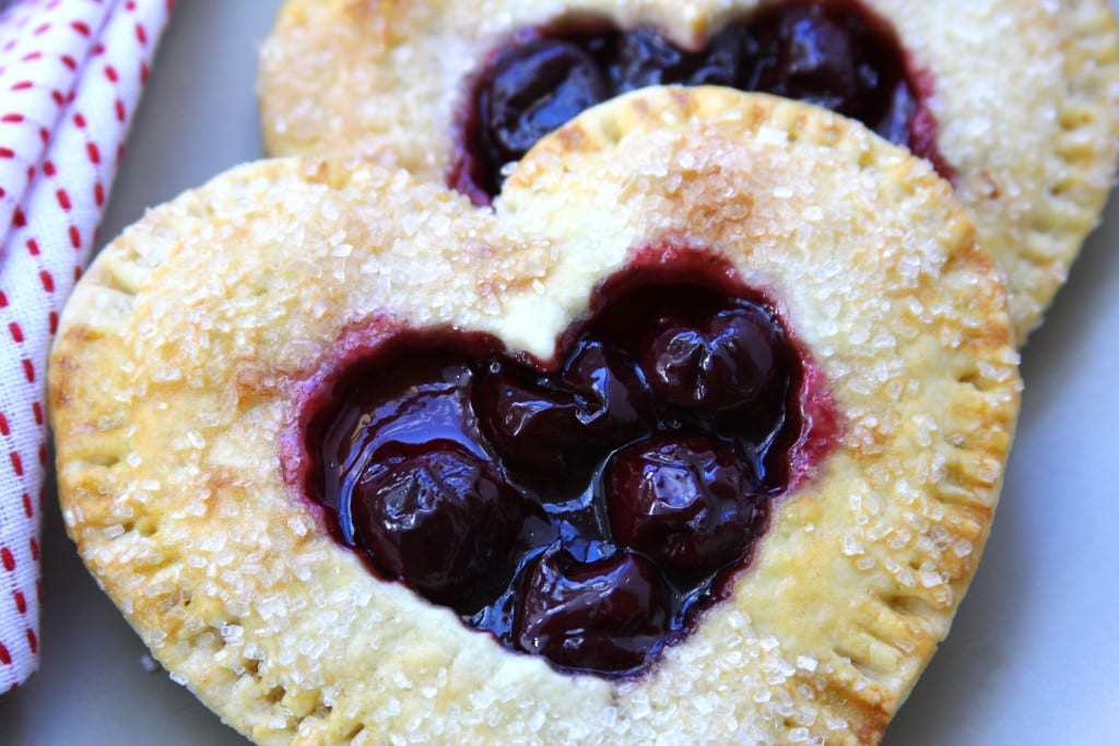Cherry Heart Pies recipe- individual pies with flaky, buttery crust and sweet cherries. No corn syrup and made with pure ingredients.