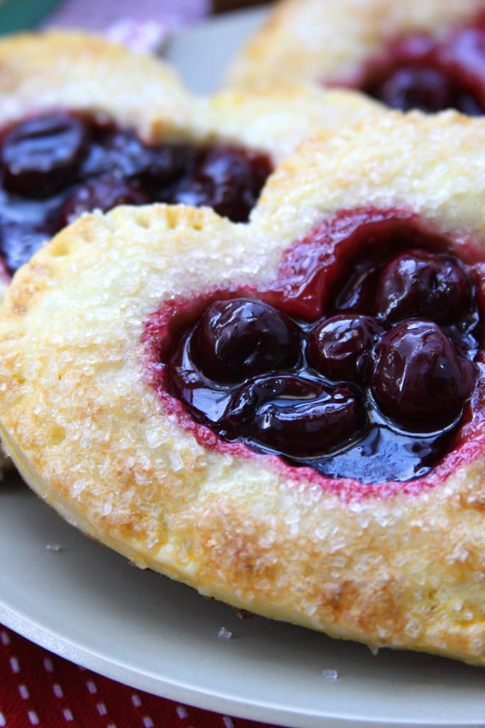 Cherry Heart Pies on a grey plate.