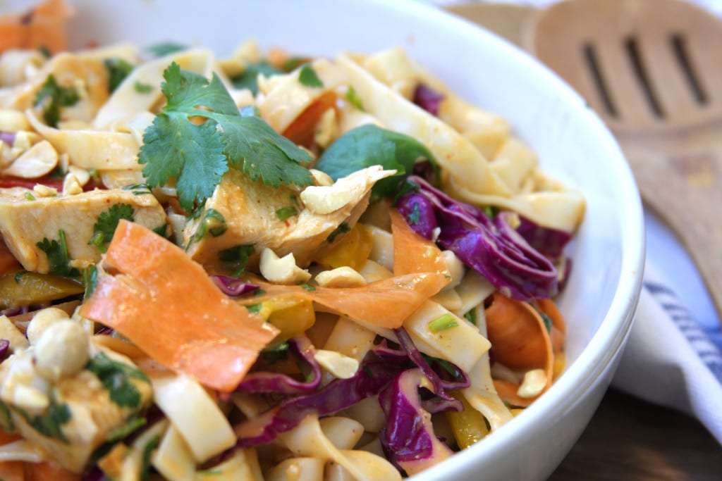 Chicken Peanut Udon Noodle Salad recipe is a cold pasta salad with flavors of sesame oil, peanut butter, sriracha and lime. Such a fun way to eat veggies in the colors of the rainbow. My husband was drooling over this dish.