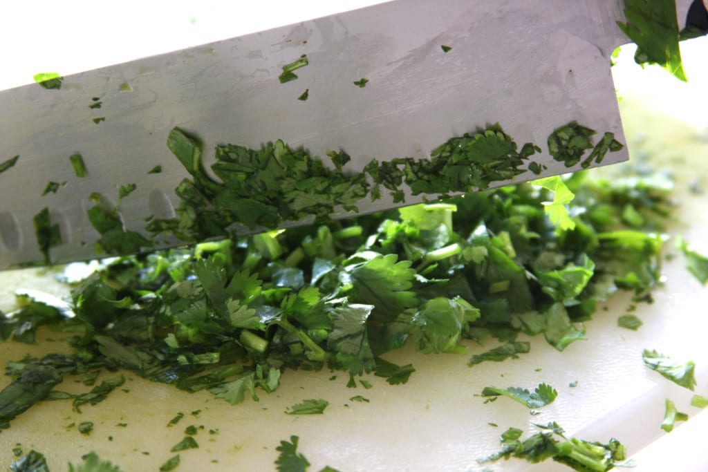 Finely chopping parsley for Chimichurri Sauce.