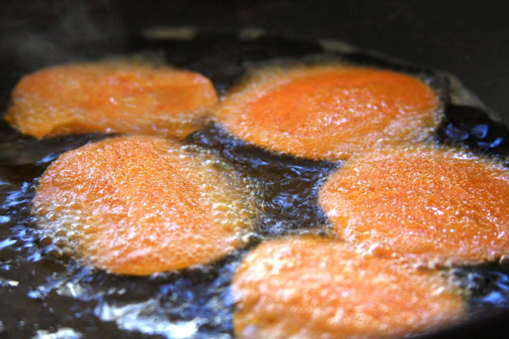 Frying the Homemade Sweet Potato Chips in coconut oil.