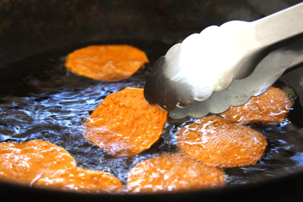 Turning the Homemade Sweet Potato Chips while frying.