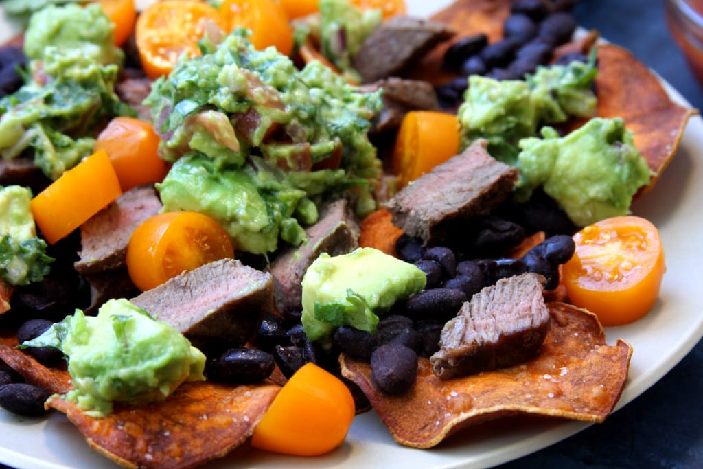 Super Healthy Sweet Potato Nachos recipe has sweet potato chips, black beans, grilled grass-fed top sirloin & guacamole. Such a fun & flavorful dinner. Gluten, corn, dairy free & perfect for those on the elimination diet.