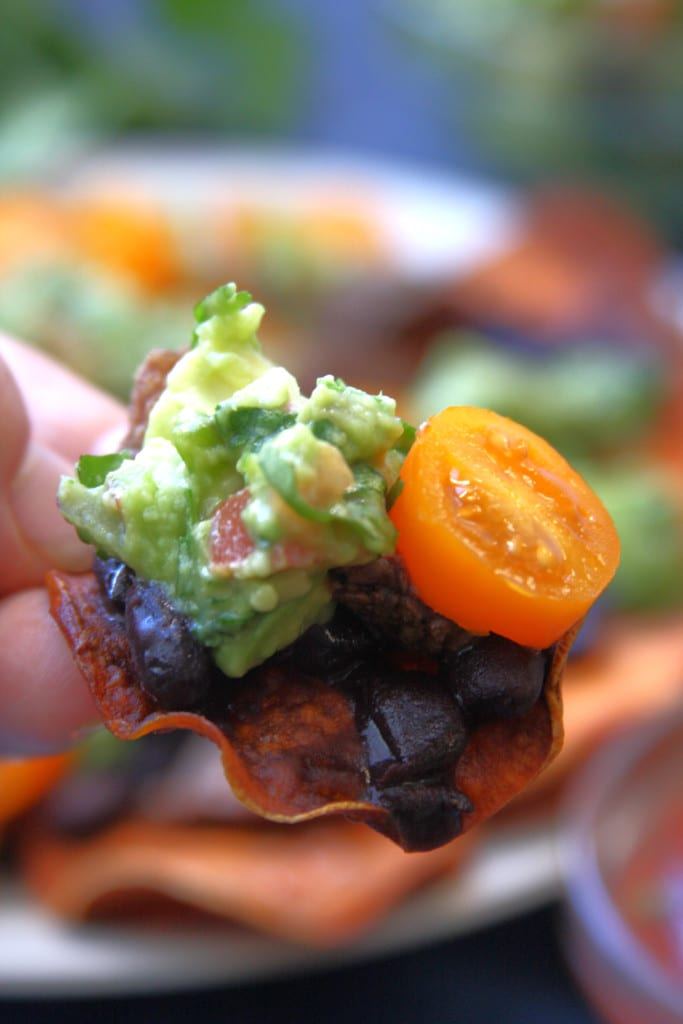 Super Healthy Sweet Potato Nachos recipe has crispy sweet potato chips, tender grass-fed top sirloin, nutrient rich black beans and zesty guacamole. Perfect for those on the elimination diet or just wanting a fun gluten free dinner.