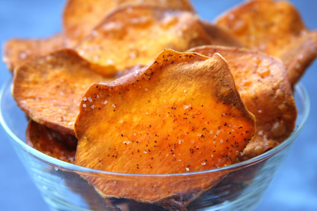 Homemade Sweet Potato Chips are cooked in coconut oil and kissed with chili powder. The perfect chip for healthy nachos.