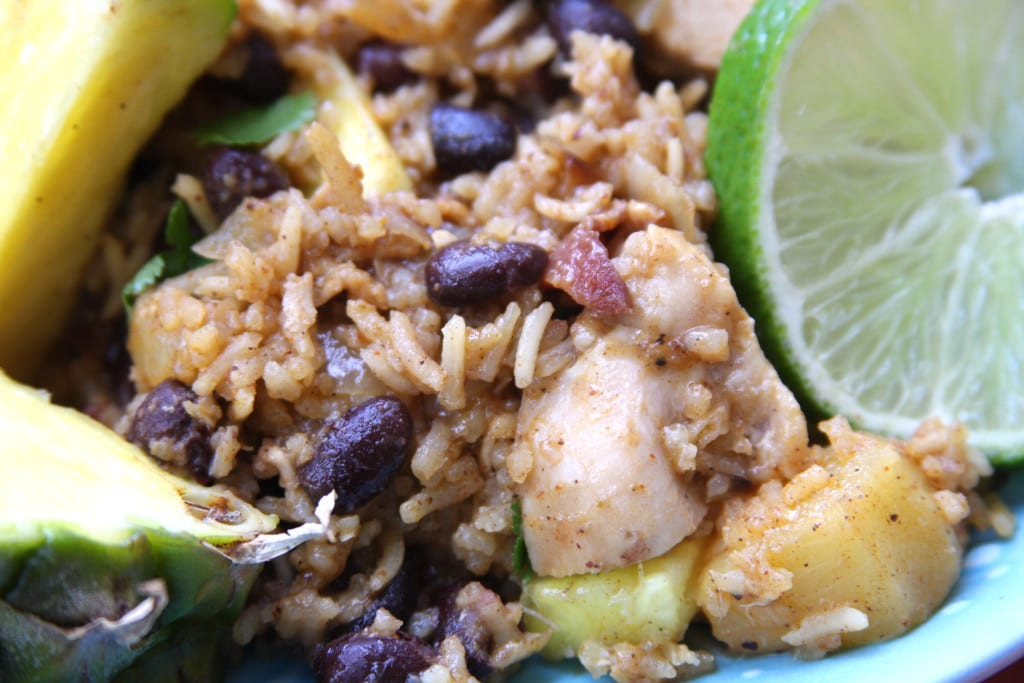 Caribbean Chicken & Rice recipe will transport you on a tropical vacation with sweet pineapple, savory bacon, satisfying black beans and Caribbean spices.