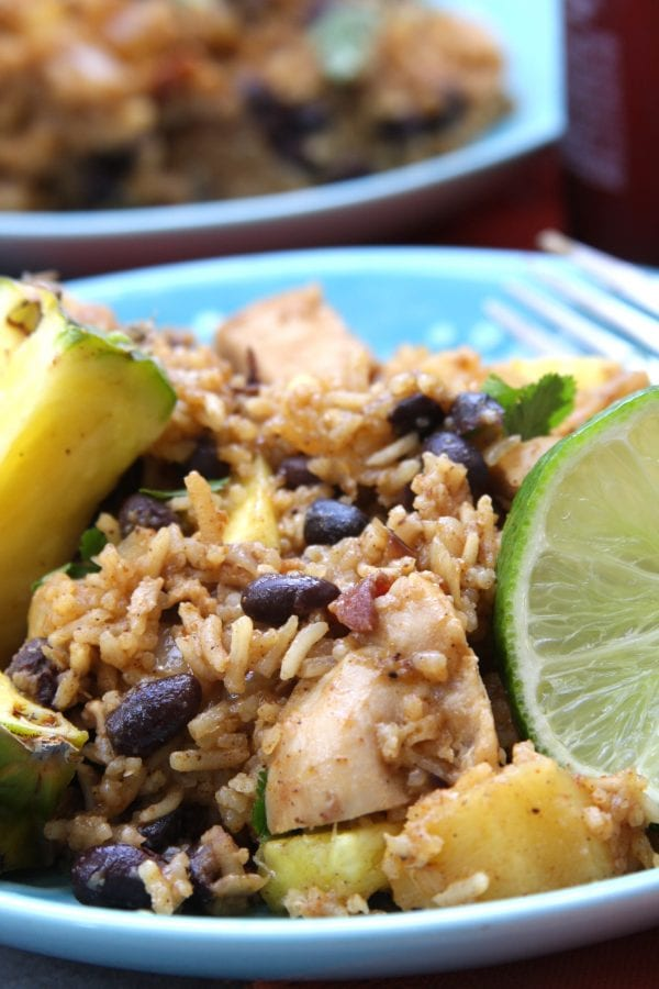 Caribbean Chicken & Rice recipe has the sweetness of pineapple , savory bacon and the spices of the Caribbean. Incredibly easy to make and perfect for any time of the year.