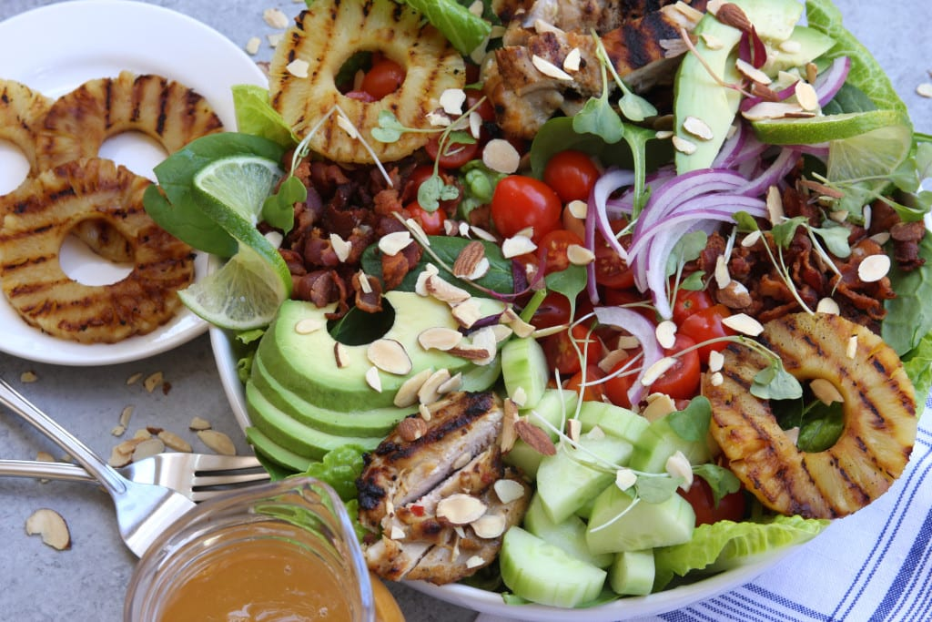 Grilled Pineapple Sesame Chicken Salad recipe has caramelized pineapple, savory bacon, creamy avocado and a tangy pineapple lime dressing. This was a hit at a family get together.