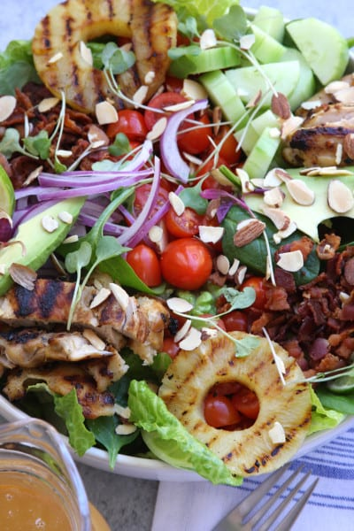 Grilled Pineapple Sesame Chicken Salad recipe is an absolute crowd pleaser. Perfect salad for company or a holiday get together.