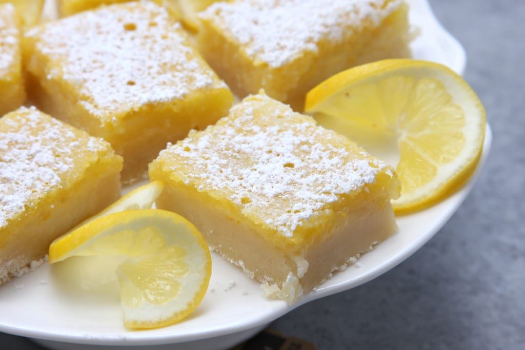 Lusciously Lemon Bars recipe is the perfect mouth watering treat for the lemon lovers in your life. Sweet, buttery and the companion with a cup of tea. These sunny little treats disappeared so fast.