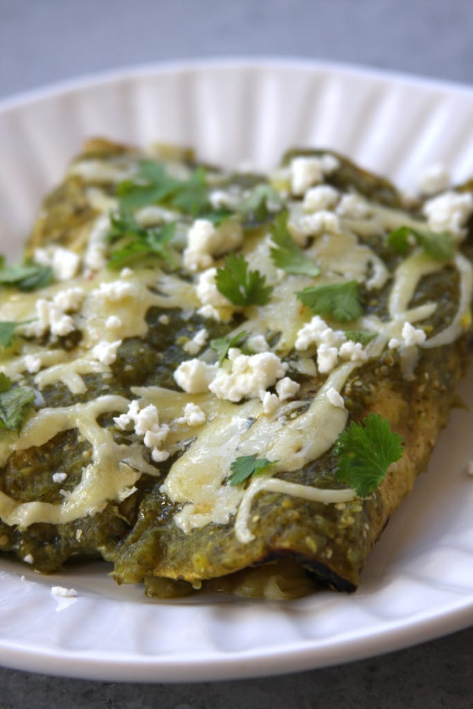 Lightened Up Salsa Verde Chicken Enchiladas recipe is lower in calories than your traditional enchilada but bursting with the same wonderful flavors. This is a family favorite that puts a smile on everyone's face.