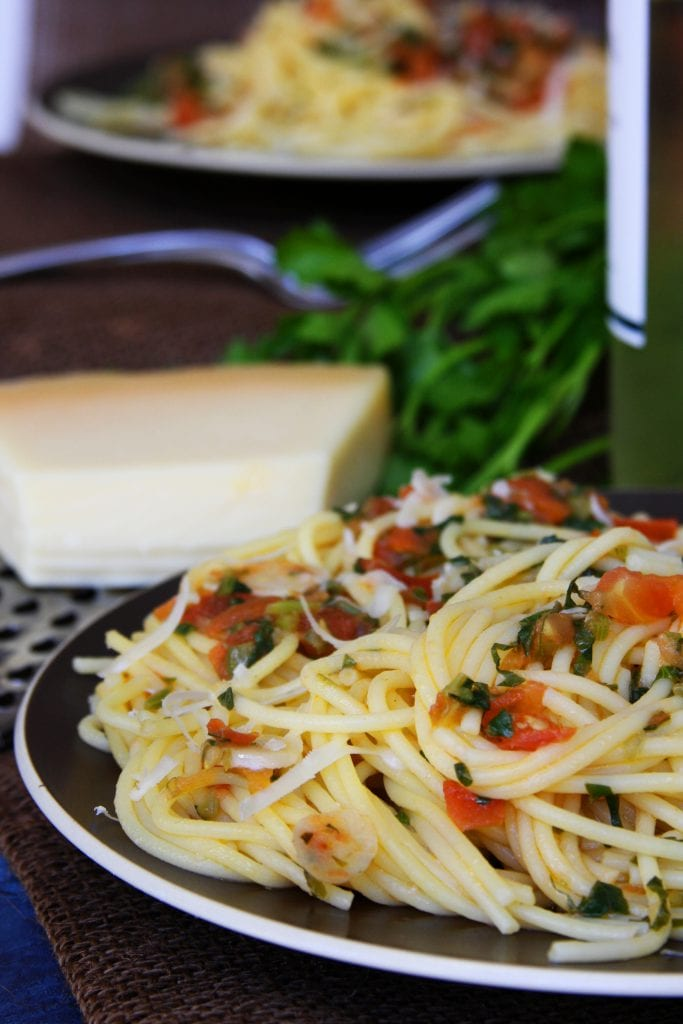 Tomato Caper Pasta is a light & savory dish. Capers, thinly sliced garlic, fresh tomatoes and Italian parsley surround tantalizing al dente pasta. Have this with a glass of chilled white wine and you will feel carried away to a café in Italy.