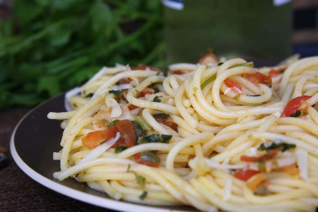 Tomato Caper Pasta recipe is a light & savory meal with fresh Italian parsley, tomatoes, capers and slivered garlic.
