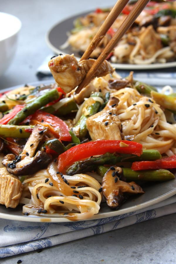 Lemongrass Chicken Noodle Stir Fry recipe is healthy decadence on a plate. It has asparagus, onions, shiitake mushrooms and red bell pepper. This made my family happy.