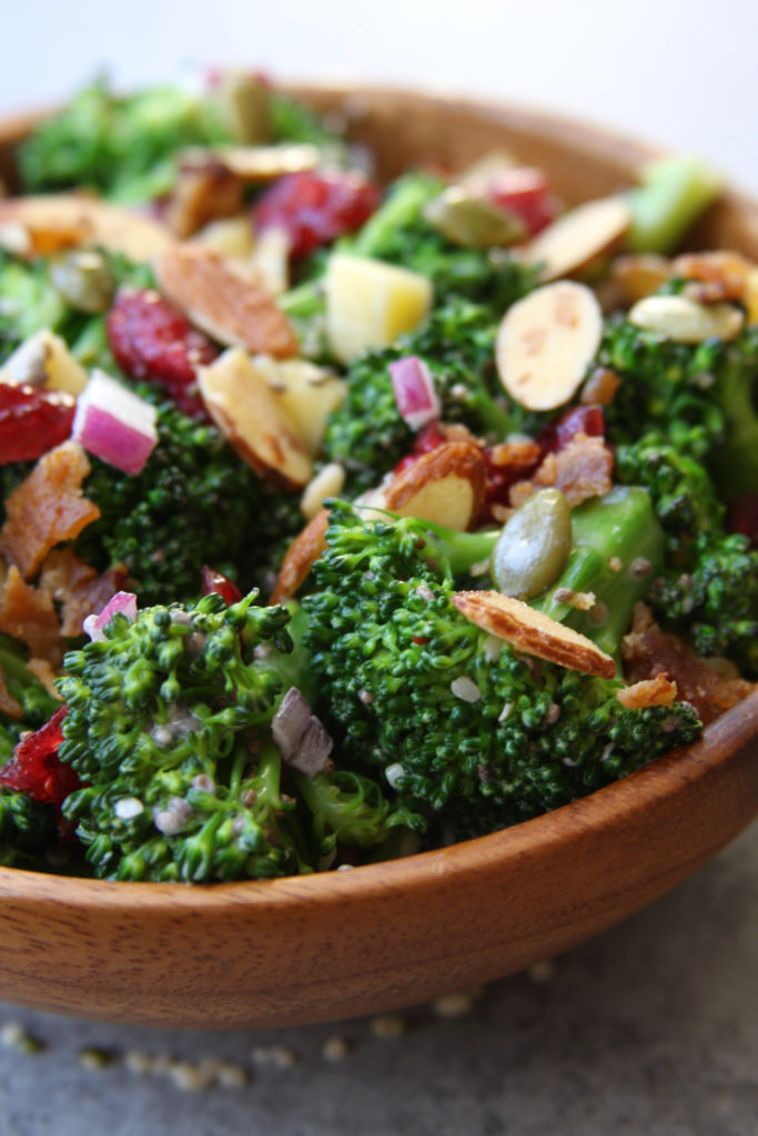 Super Healthy Broccoli Salad recipe is a twist on a classic with yogurt, pepitas , chia and hemp seeds. Everyone gobbles this salad up and loves the crunch.