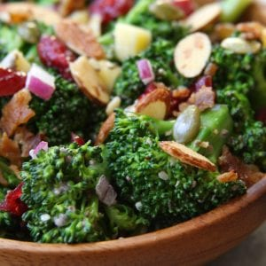 Super Healthy Broccoli Salad recipe is a twist on a classic with yogurt, pipits , chia and hemp seeds. Everyone gobbles this salad up and loves the crunch.