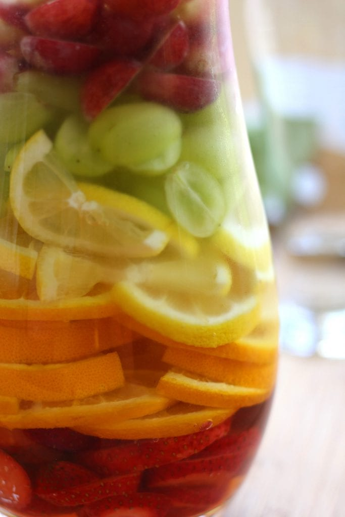 Rainbow Tequila Sangria recipe is a refreshing adult cocktail with strawberries, citrus and grapes all mingled with crisp sauvignon blanc and your favorite tequila. It is as much to look at as it is to drink.
