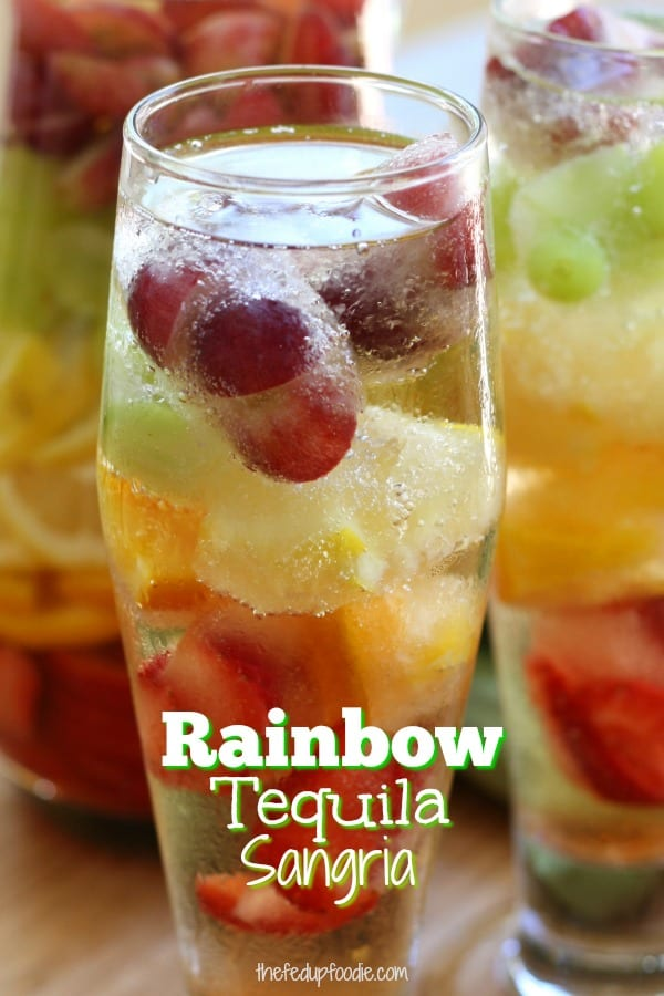Rainbow Tequila Sangria recipe is a refreshing adult cocktail with strawberries, citrus and grapes all mingled with crisp sauvignon blanc and your favorite tequila. It is as much to look at as it is to drink. #thefedupfoodie #tequiladrinkrecipes #sangriatequila #sangriarecipes #sangria #mixeddrinks #sangriadrinks #sangriausingfrozenfruit https://www.thefedupfoodie.com