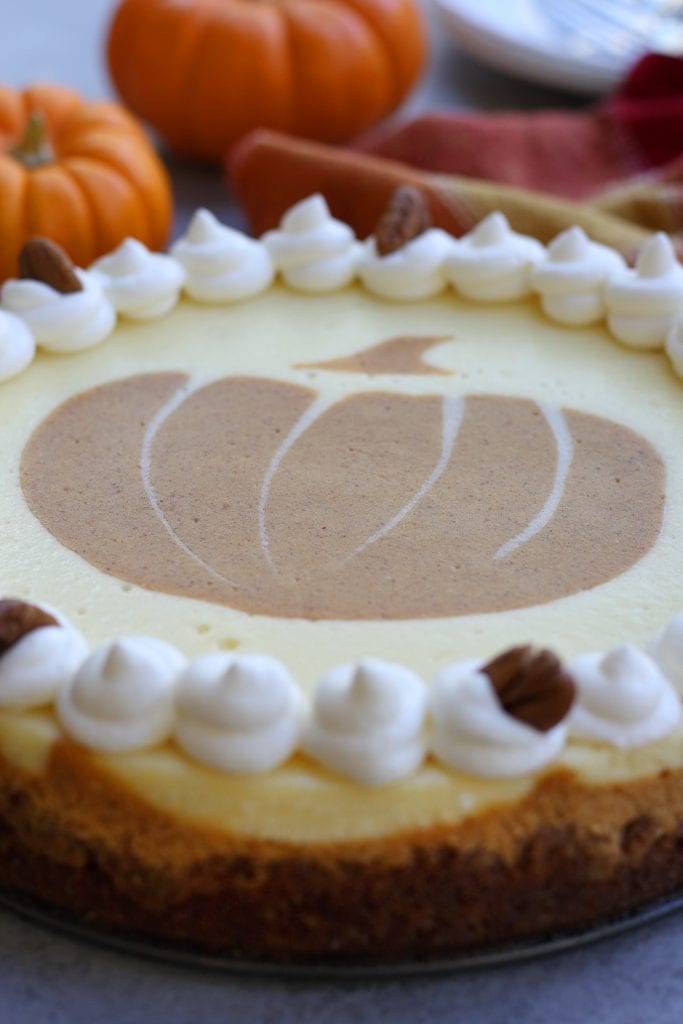 Creamy and decadent, this Pumpkin Cheesecake stands above the rest with a gingersnap, graham and pecan crust. Layered pumpkin and vanilla cheesecake makes this a beautiful and delicious dessert for your Holidays.