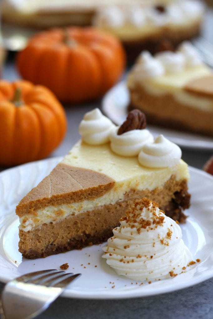 Creamy and decadent, this Layered Pumpkin Cheesecake stands above the rest with a gingersnap, graham and pecan crust. Layered pumpkin and vanilla cheesecake makes this a beautiful and delicious dessert for your Holidays.