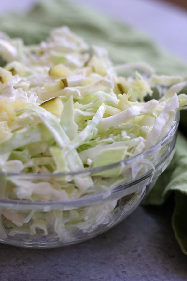 Simple Coleslaw is an easy and delicious side dish that comes together in minutes. Low-carb and gluten free, it's the perfect companion to many a dish.