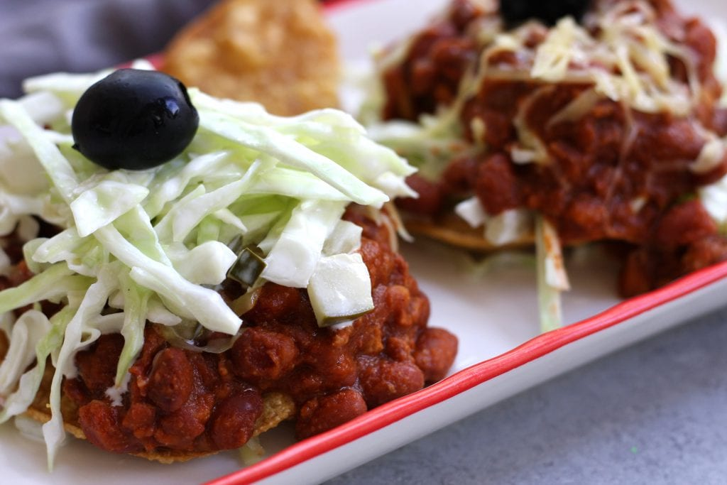 Tortilla and Beans is a family recipe dating back over 70 years. A crispy corn tortilla is topped with a hearty chili, simple coleslaw and black olives. Delicious, satisfying and budget friendly, this is a meal my husband can't get enough of.