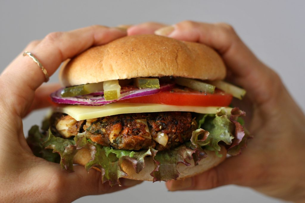 Black Bean Veggie Burgers recipe is completely Vegan and incredibly satisfying that even meat eaters love these. Made with quinoa, almonds, sweet potatoes and broccoli it is one of the best tasting and guilt-free meals around.