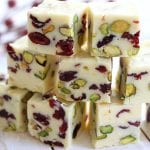 Mildly sweet, beautifully festive and bursting with the fresh flavor of citrus. Simple Orange Cranberry Fudge is a wonderful addition to your Holiday table