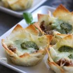 Crispy, cheesy and bursting with flavors of Italian Sausage and pesto, these Italian Cheesy Bites are a wonderful appetizer for your Holiday get togethers.
