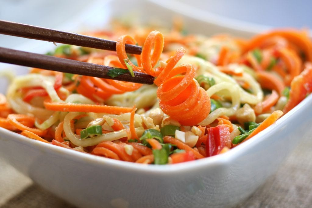 Incredibly healthy and delicious, Carrot Cucumber Asian Slaw will satisfy your taste buds and hunger alike. Perfect as a light lunch or dinner with it's fresh, crunchy veggies and the creamy nuttiness of a sesame, peanut dressing.