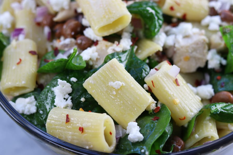 Zesty Chicken Pasta Salad has a subtle balance of tang to spice with red chili pepper flakes, feta, onion and garlic. Simple, fresh and easy to make, this pasta salad is perfect anytime of year.