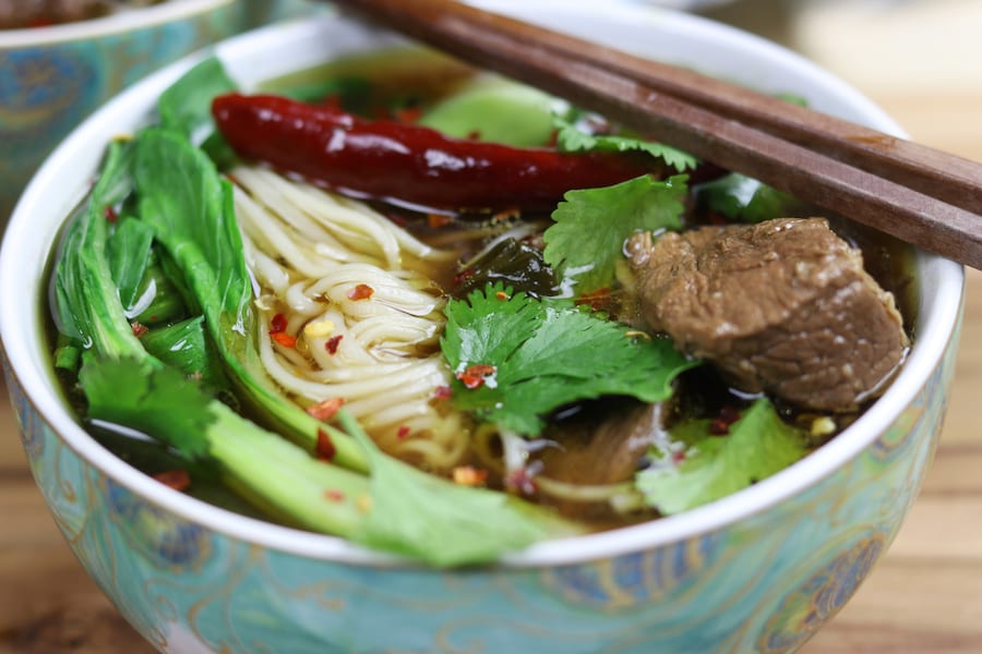 Beef Asian Noodle Soup is love at first bite or should I say Slurp? Tender beef and crispy baby bok choy is served over a rich Asian spiced broth with gratifying lacy noodles.