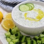 Creamy and refreshing, Tzatziki Sauce is the perfect Greek condiment with many types of meats or just simply as a dip.