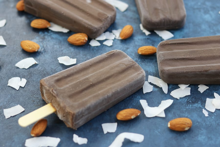 Creamy and sweetened with a kiss of honey, these Almond Joy Fudgesicles are a wonderful no-guilt popsicle that the whole family will love.