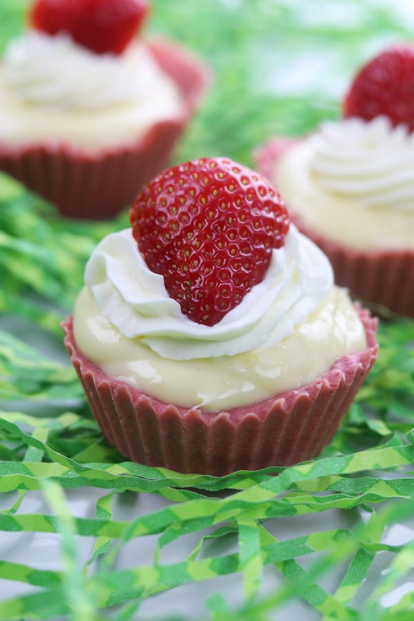 Strawberry Lemon Yum Cups are 50% candy, 50% pie and 100% delicious. A lemon cheesecake filling sits nestled in strawberry white chocolate cups, all topped with whipped cream and sliced strawberries. Nobody can stop at one.