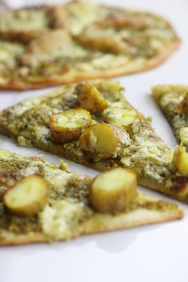 Potato Gorgonzola Pesto Naan Pizza is such a fun twist from the traditional Friday night pizza. Nutty pesto plays so well with the buttery potatoes and Italian gorgonzola. This recipe has become a major hit in our house.