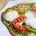 Light and summery, Heirloom Tomato Pesto Naan Pizza is a quick and easy recipe perfect for curing the take out cravings.