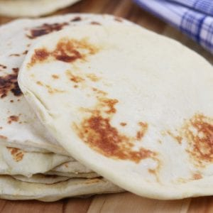 Learn the basics of making Homemade Naan, an easy & fluffy skillet bread that goes perfectly with Indian dishes or can be used to make pizza.