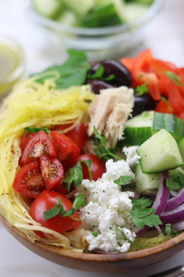 Spaghetti Squash Greek Bowls are an easy low-carb meal perfect for summer. Mix and match your favorite Greek toppings and drizzle on the popular dressing. You will love these!